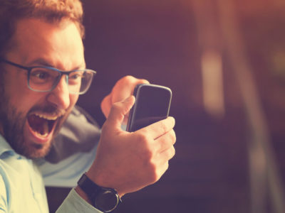 Man screaming at phone because of courtesy disconnect